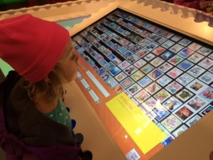 Molly Checking Out the Touchscreen Table.