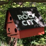 Look for little red bird houses, like this one, all over Rock City.