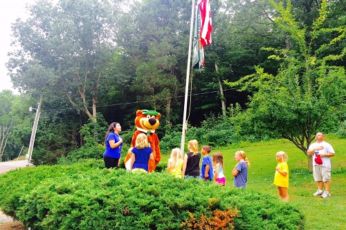 The kids loved the morning flag raising ceremony with Yogi Bear.