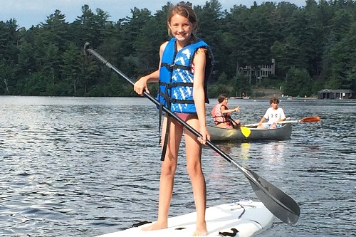 clare on paddleboard lake placid