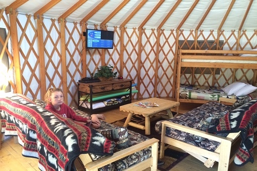 The family room and sleeping area inside our yurt