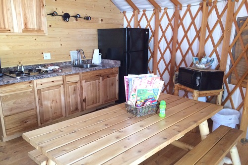 The kitchen and dining area inside our yurt