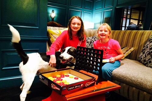 Enjoying snacks and Connect Four in the lobby of Hotel Monaco.