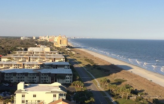 Taking in the view from our Forest Dunes condo on the 17th floor.